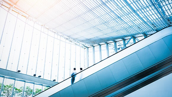 people on blue escalator