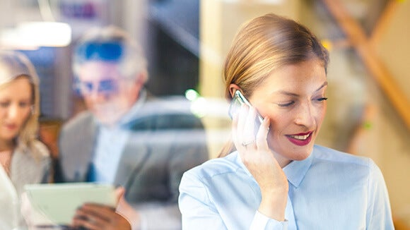woman excused from meeting on phone